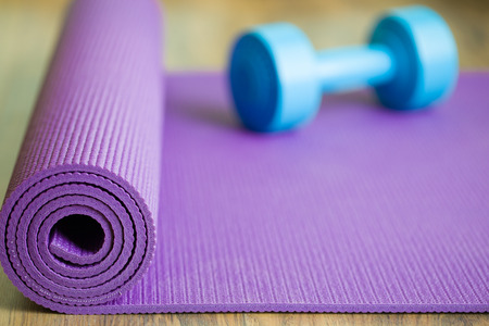 yoga mat and dumbbell Stock Photo