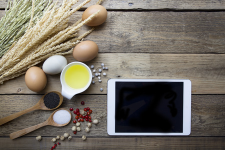 ingredient: Food ingredients , kitchen utensils and tablet for cooking on wooden background Stock Photo