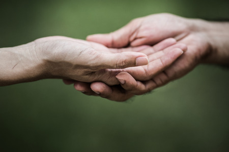 the human hand: Giving a helping hand to another