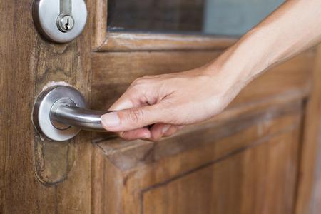 close-up hand hold handle of old wood door
