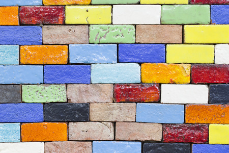 tile wall: close-up colorful brick row in the garden