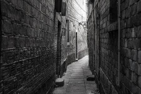 back gate: Dark alley in old part of town Stock Photo