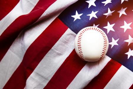 sport background: baseball with American flag in the background