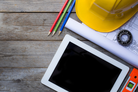 construction helmet: Tablet computer with architecture and construction tools