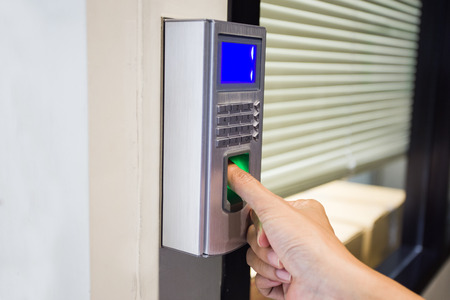 fingerprint and password lock in a office building 写真素材