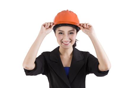 safty: Female engineer touching safty helmet on a white background Stock Photo