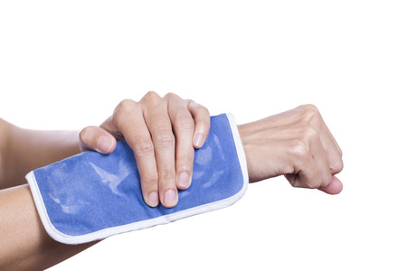 hurting: Cool gel pack on a swollen hurting wrist Stock Photo