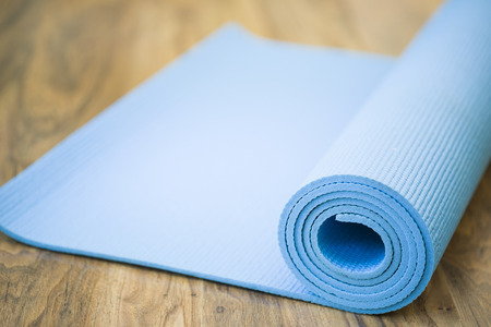 four classes: yoga mat on the fitness classroom Stock Photo