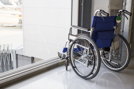 disablement: Empty wheelchair parked in airport Stock Photo