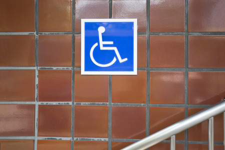 invalidity: The blue sign indicating on wheelchair usage in the city Stock Photo