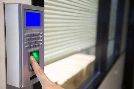 fingerprint and password lock in a office building Standard-Bild
