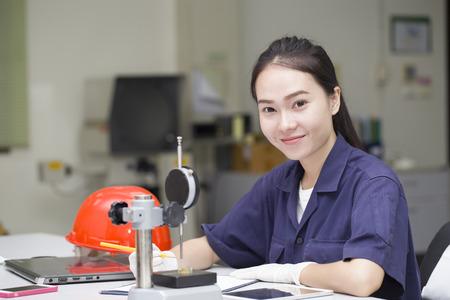 woman engineer use vernier height gauge