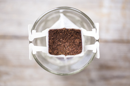 brewed: Instant freshly brewed cup of coffee,Drip bag fresh coffee Stock Photo