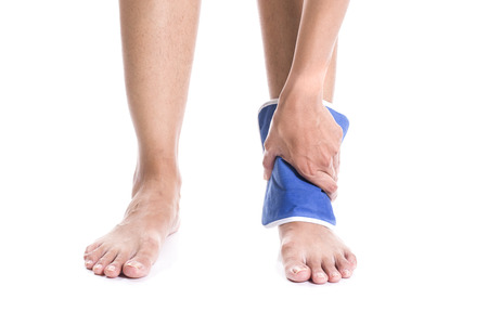 hurting: Cool gel pack on a swollen hurting ankle Stock Photo