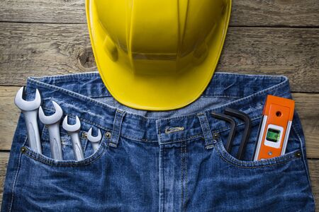 toolset: Safety helmet and tools in a jeans pocket