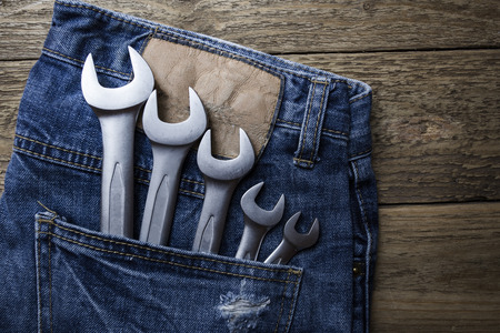 toolset: tools in a jeans pocket Stock Photo