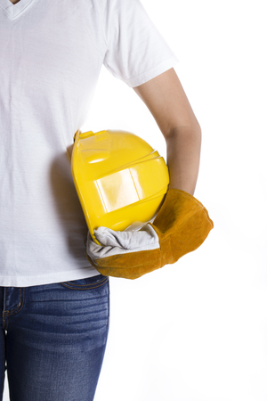 industrial site: female engineer hand holding yellow helmet on white background