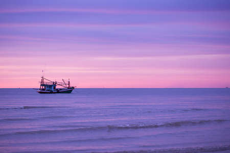 Traditional fishing boats at sunrise