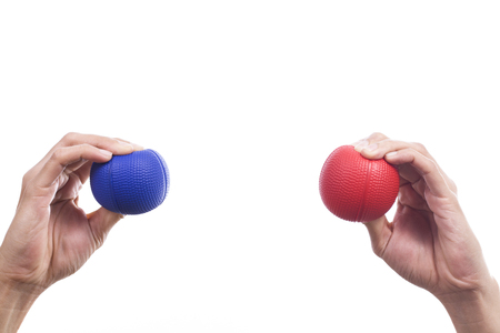 ball: Hands of a woman squeezing a stress balls Stock Photo