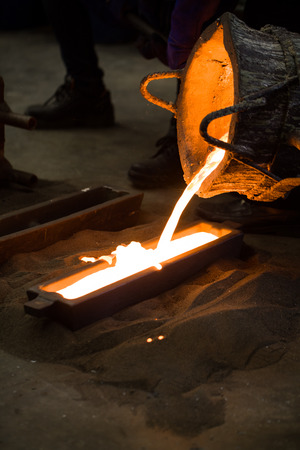 smelting plant: close up metal casting process in the factory