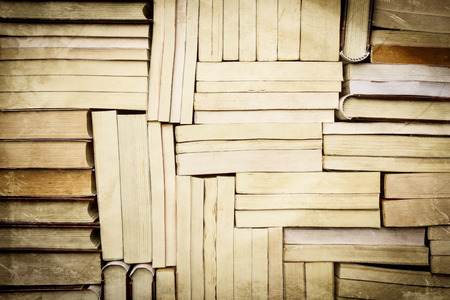 paperback: image of a stack of paperback books, vintage style