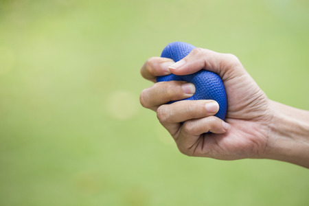 stress ball: Woman hand squeezing a stress ball