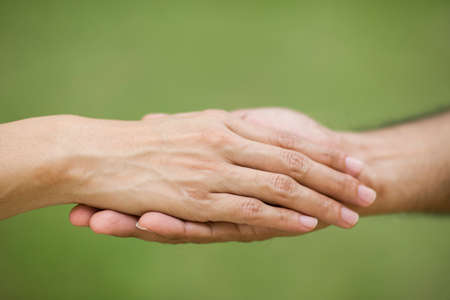 hand by hand: Giving a helping hand to another