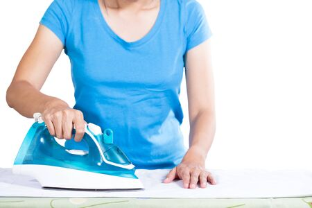 homecare: woman ironing clothes on ironing board, white background Stock Photo