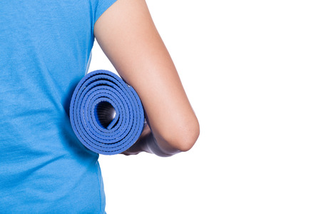 yoga mat: Young woman holding a yoga mat on white background
