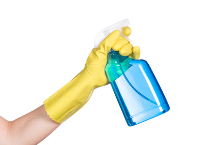 solvent: Hand in yellow protective glove spraying cleaning liquid on white background