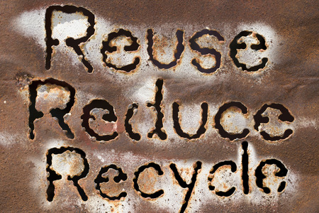 earth pollution: Reuse, Reduce, Recycle word on rust metal texture