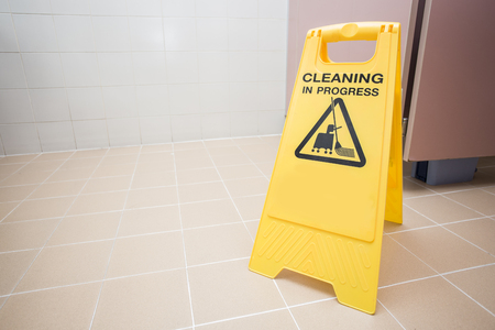 signs symbols: cleaning progress caution sign in toilet Stock Photo