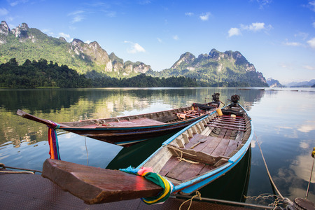 sok: landscape and long-tailed boat in Ratchaprapha Dam at Khao Sok National Park, Surat Thani Province, Thailand Stock Photo