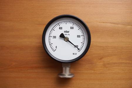 compression: pressure gauge on wood background