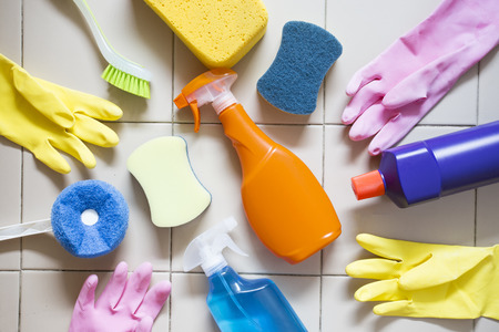 office cleanup: House cleaning product on tiled floor