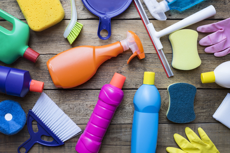 wood house: House cleaning product on wood table Stock Photo