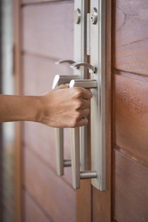 room door: hand hold handle of wood door