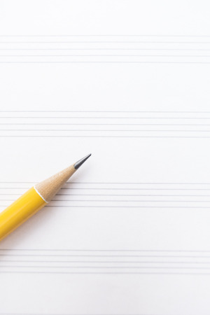 sheet music: Music sheet and yellow pencil