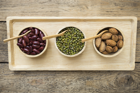 kidney bean: Group of beans on wood table background