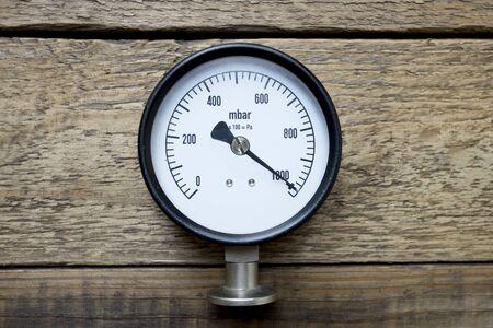 pressure gauge: pressure gauge on wood background