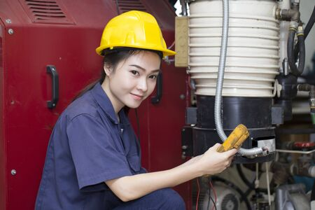 asian sport: young woman engineer setup testing machine Stock Photo