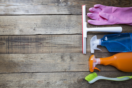clean office: House cleaning product on wood table Stock Photo