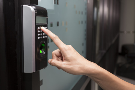 lock: fingerprint and access control in a office building Stock Photo