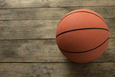 international basketball: Basketball on old wood table