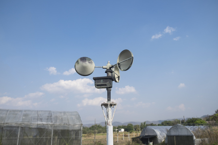 anemometer: Anemometer in a farm with blue sky Stock Photo
