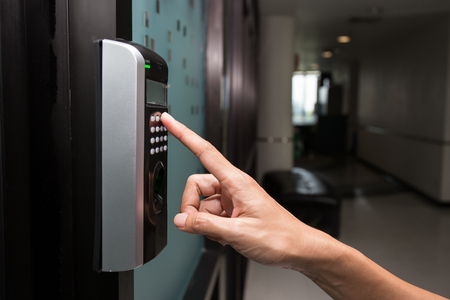 fingerprint and access control in a office building Stockfoto