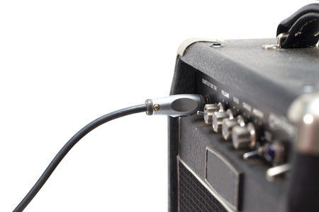 disconnecting: jack connector into the amplifier guitar Stock Photo