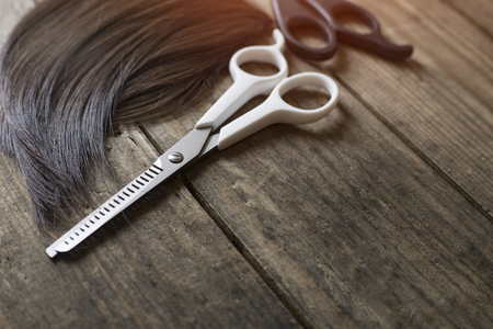 hairdresser tools on old wood table