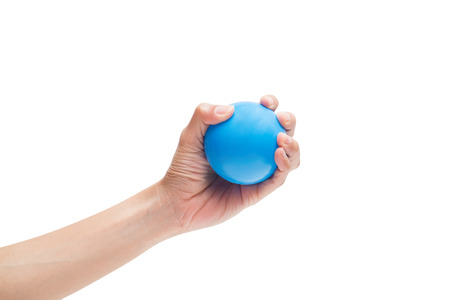 Hands of a woman holding a stress ball