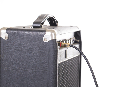 unplugging: jack connector into the amplifier on white background